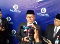 Deputi Gubernur BI Soegeng (tengah) didampingi Kepala Perwakilan BI Malang Azka Subhan Aminurridho (kanan) di Hotel Harris & Convention Malang, Senin (14/1/2019)